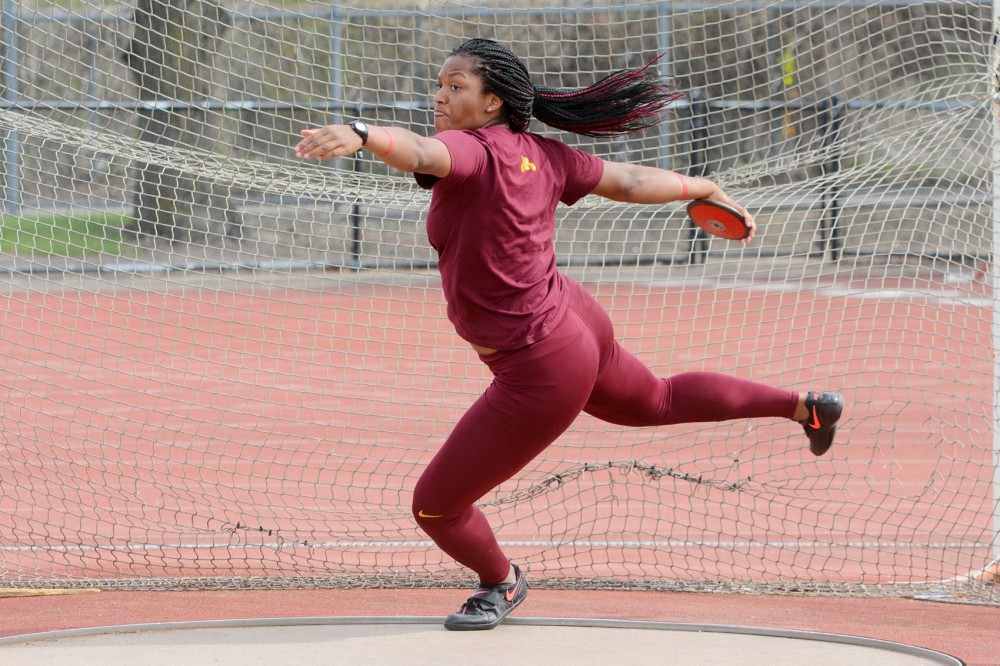 Redshirt senior Devin Stanford practices disc throwing at the Bierman Track and Field Stadium Thursday. Stanford broke the program record in the hammer throw earlier this season.