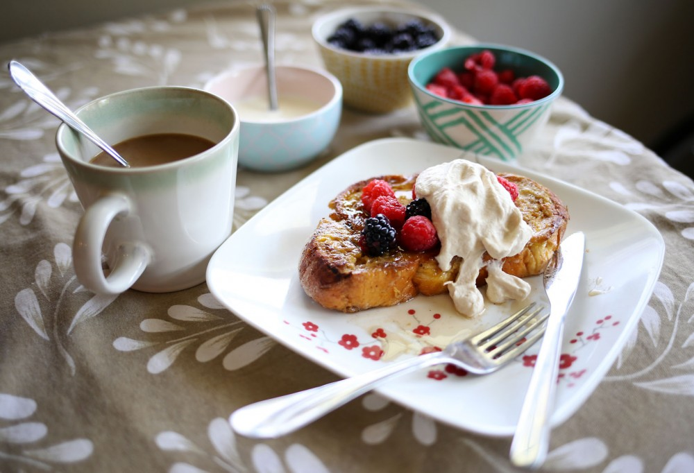 French toast made with Challah bread topped with fresh berries and whipped cream.