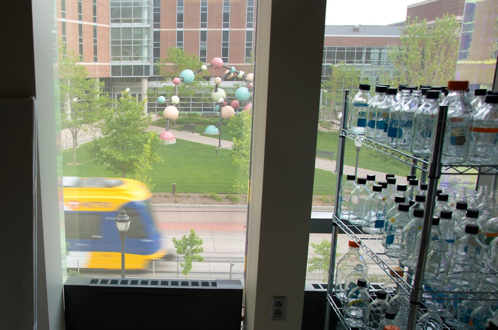 A light rail train passes outside Amundson Hall on Friday evening. Electromagnetic radiation and vibrations from the trains could disturb University research.