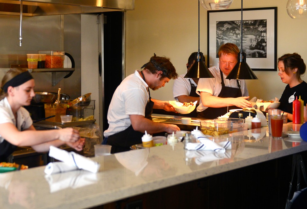 Cooks prepare food at recently opened Nighthawks Diner in South Minneapolis on a Thursday evening.