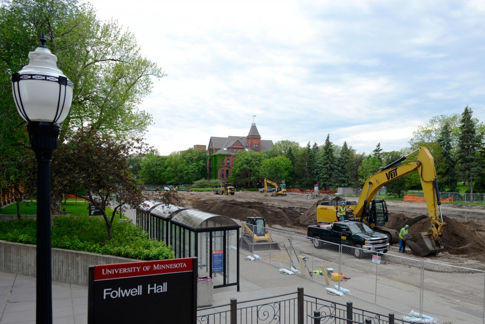 On the East Bank campus, Pleasant Street undergoes renovation as workers make progress with construction on Monday afternoon. The project aims to widen the street to allow for safer bike lanes and pedestrian crossings, due for completion in September 2015.