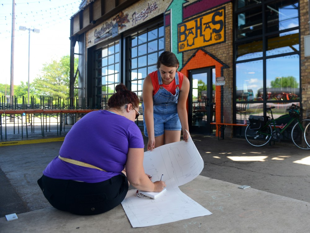 Northeast Night Market organizers Margie and Madeline Siggelkow plan the layout of their upcoming event at Bauhaus Brewery on Sunday, June 13. The market, which showcases thirty local artisan vendors, musicians and street performers, will take place on Tuesday, June 23.