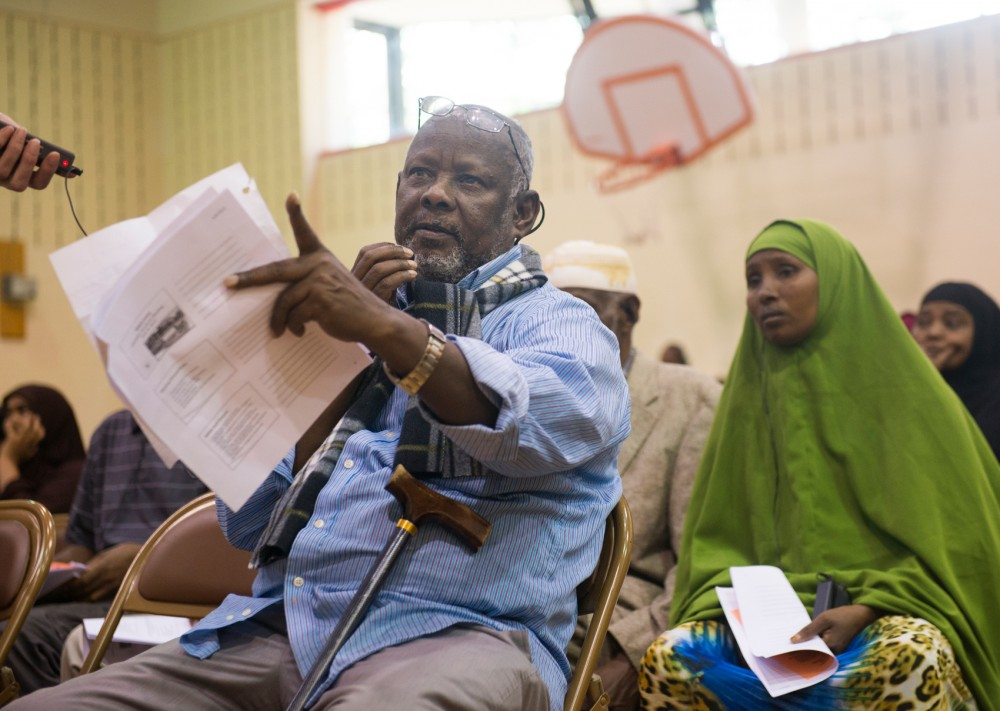 Glendale tenant Abdirahman Mohamed expresses his concerns to Minneapolis Public Housing Authority officials during an informational meeting at Luxton Community Center on June 8.