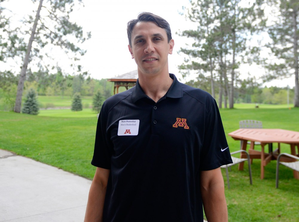 Gophers men's basketball assistant coach Nate Pomeday poses for a photo at the Gopher Road Trip: Chalk Talk in Detroit Lakes, Minn., on May 28, 2015.