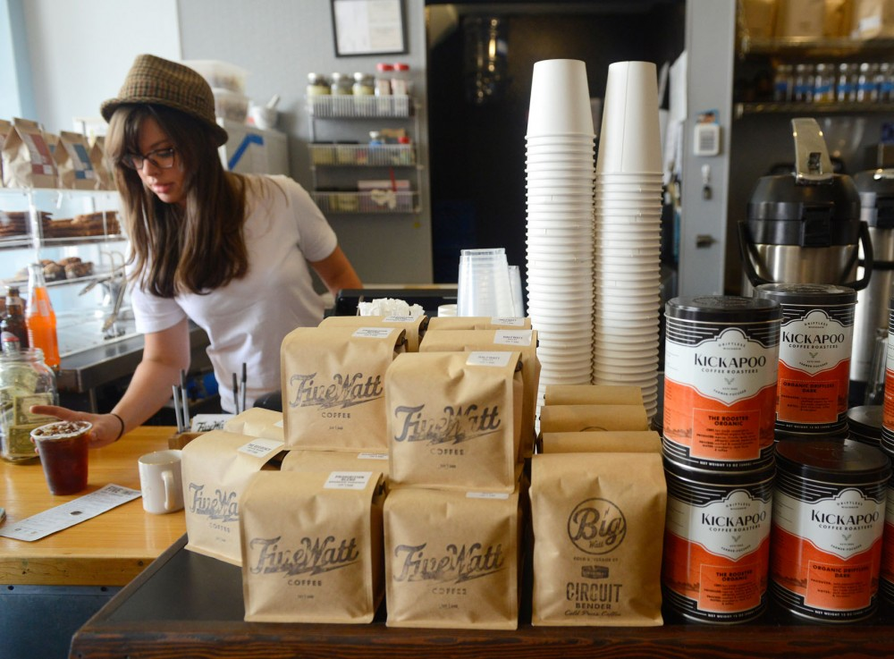 Barista Bethany Brown serves up a customers iced coffee at Five Watt Coffee on Tuesday.