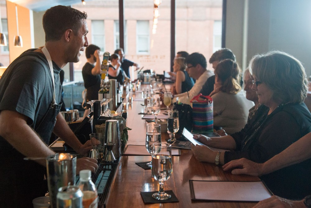 A bartender at Saint Dinette takes customers' orders on Thursday evening. The new restaurant recently opened in the Lowertown neighborhood of St. Paul.