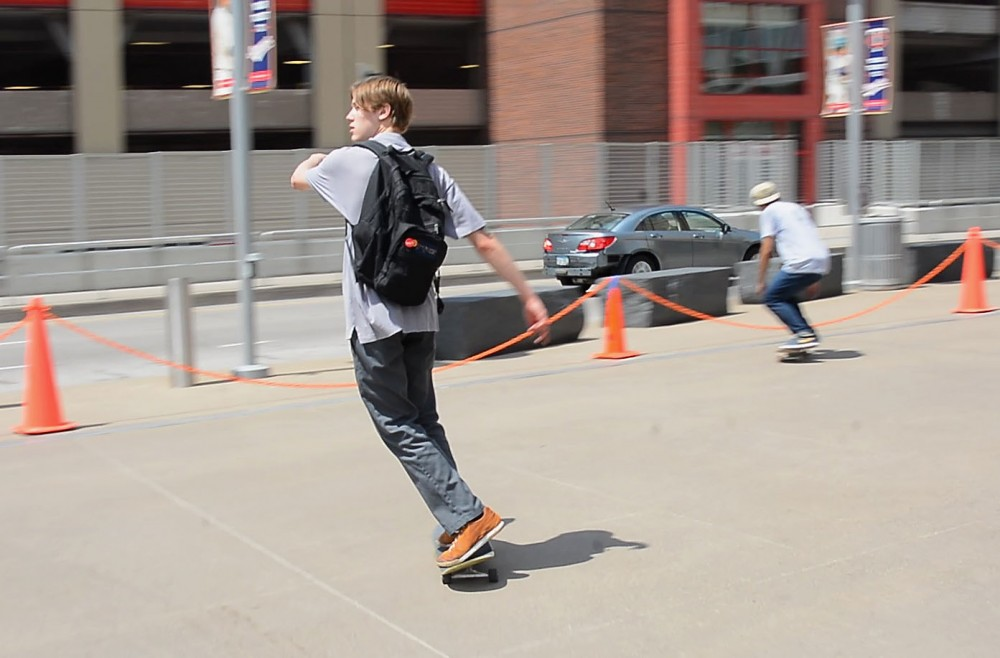 Local skater and City of Skate supporter, Carl Forsline, skateboards through downtown Minneapolis nearby Target Field on Friday afternoon. City of Skate, a local organization, advocates for the skating community of the Twin Cities.