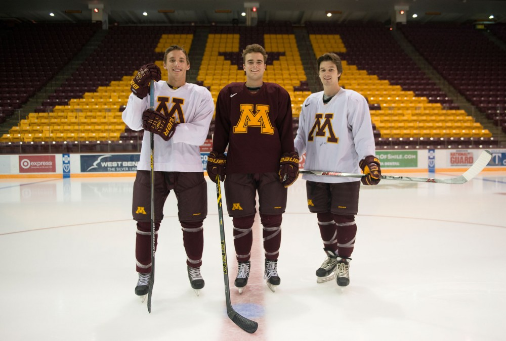 (left to right) Jack Sadek, Brent Gates Jr. and Tom Novak pose in Mariucci Arena on Monday. The Minnesota Gophers trio was drafted into the NHL on Saturday with Sadek going to the Minnesota Wild, Gates to the Anaheim Ducks and Novak to the Nashville Predators.