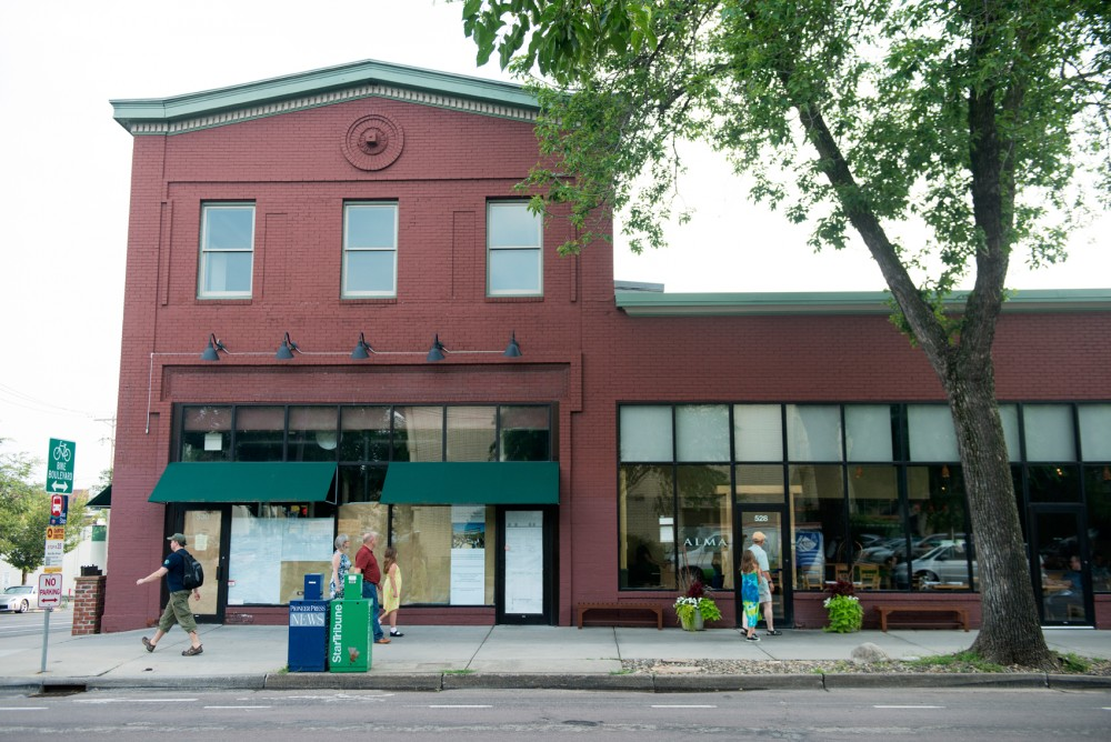 Pedestrians pass by Restaurant Alma on a Monday afternoon. Restaurant chef Alex Roberts is working with City Council member Jacob Frey to change current zoning codes to repurpose the newly acquired space to create a coffee shop and a small boutique hotel named The Inn at Alma.