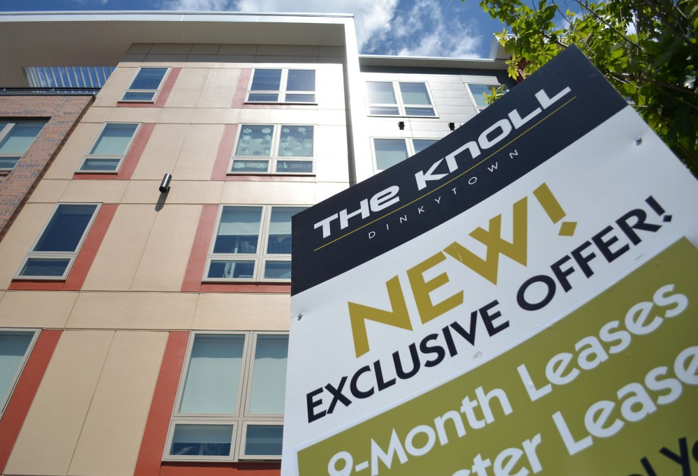 The Knoll apartments advertise on University Avenue, heavily competing with other local developments to draw in new residents in the currently oversaturated housing market.