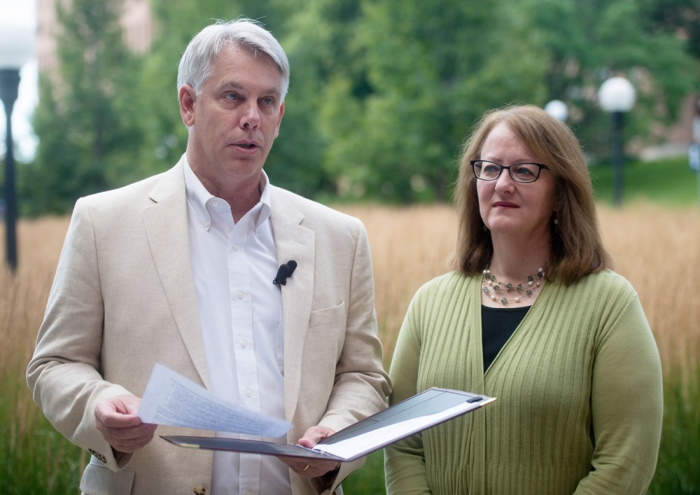 Dean of the Universitys College of Food, Agricultural and Natural Resources Sciences Brian Buhr and Vice President for University Services Pamela Wheelock deliver a statement regarding future plans for the construction of the new Bell Museum and observatory outside of the Cargill Building on Saturday, July 25.