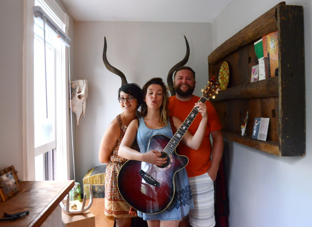 (Left to right) Amanda Churchill, Jess Smith, and Danny Churchill of Eustace the Dragon pose at Smiths home in St. Paul. The local folk band is one of many musical acts that will perform at Grounds and Sounds music festival at Groundswell in St. Paul on August 15.