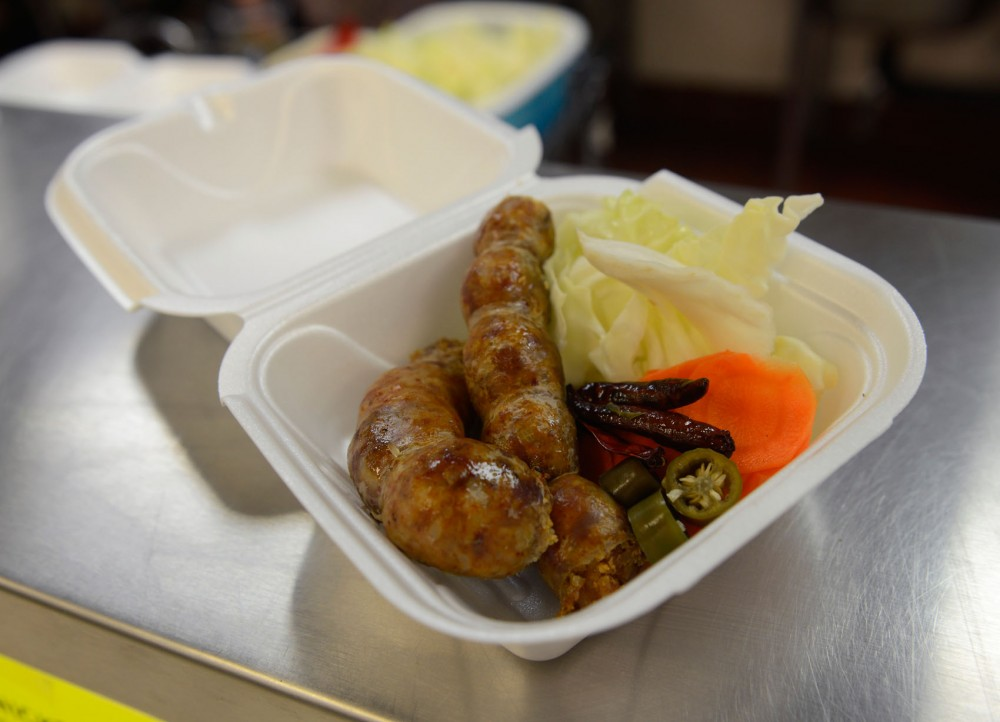 88 Oriental Foods' pork sausage is served with cabbage, sliced carrots, and pickled sliced jalapeño rings.