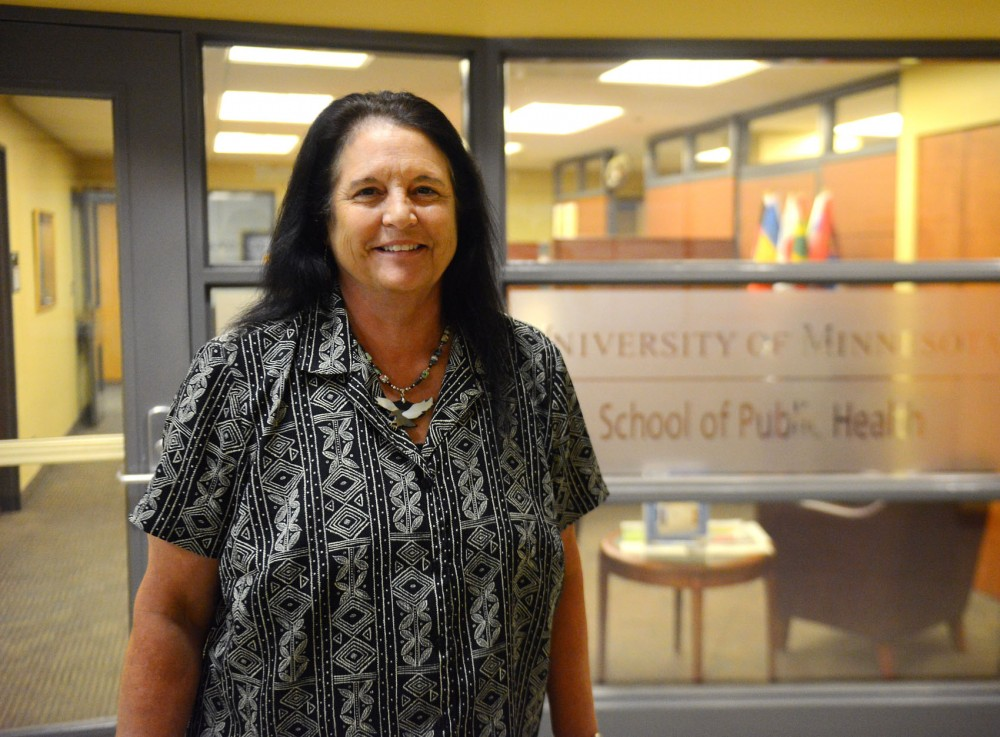 New University faculty member Linda Frizzell poses in front of the School of Public Health's dean office on Monday. Frizzell is implementing a program that will educate public health students on the different needs of Native American tribes and rural communities when making healthcare policies.