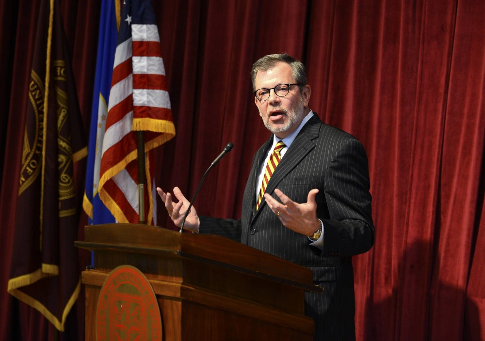 University President Eric Kaler responds to questions from the media at a press conference held in the Northrop Memorial Auditorium on July 7, 2015, regarding the resignation of now former University athletic director Norwood Teague. Teague made the decision to resign following allegations of sexual harassment from two non-student University employees.