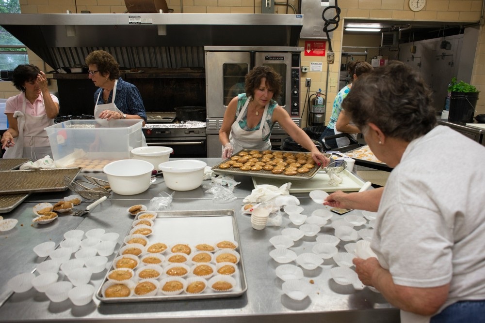 A team of women put finishing touches on melomakarona, spice cookies dipped in honey, in preparation for the bake sale at Taste of Greece on Wednesday at St. Mary's Greek Orthodox Church in Minneapolis. The festival runs Sept. 11-13 with free admission.
