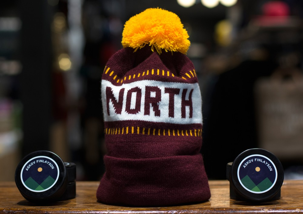 The Askov Finlayson flagship store previews one of their North Stocking Hats  on Wednesday. The hats will go on sale today and are expected to sell out quickly.