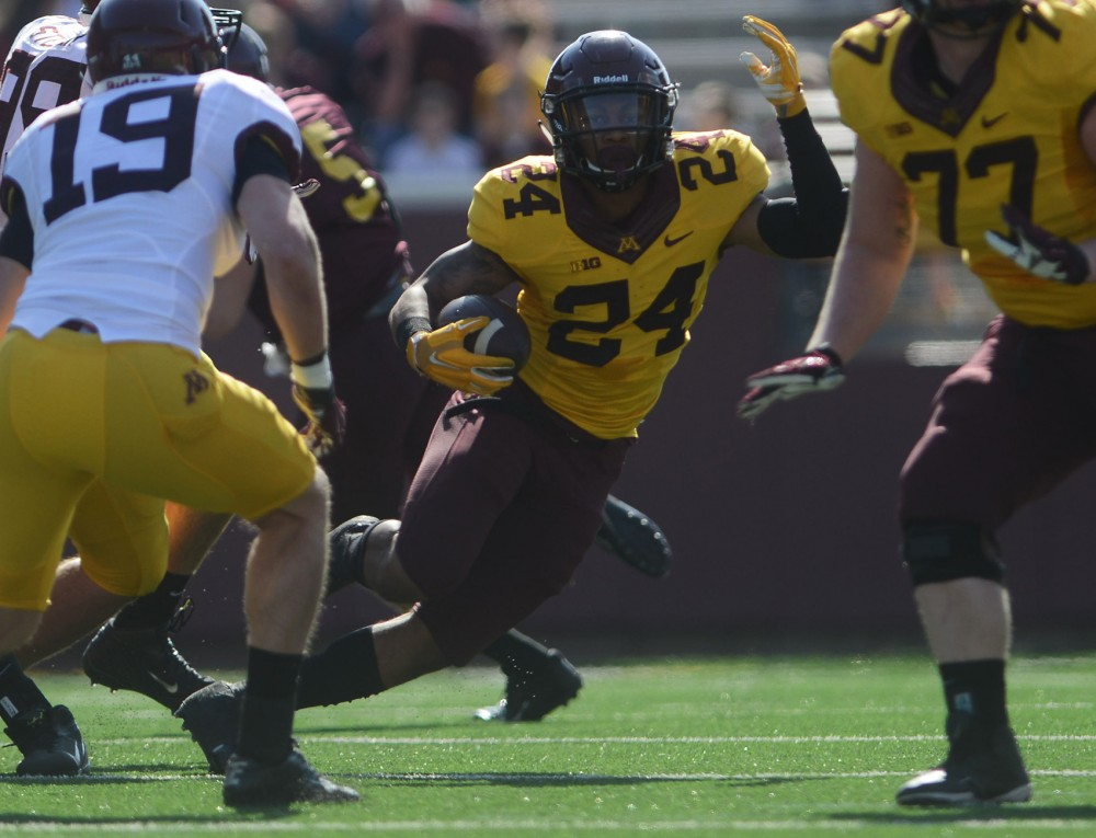 Minnesota running back Rodney Smith runs the ball during the spring game on Saturday at TCF Bank Stadium.