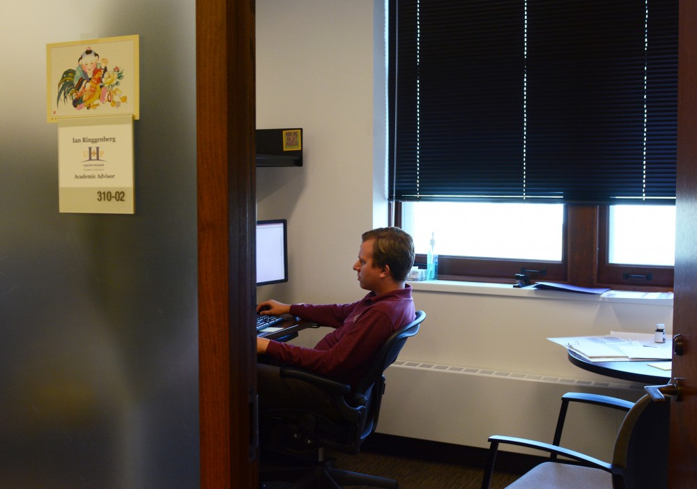 Academic Advisor Ian Ringgenberg goes about his daily work in his office on Tuesday. If the change goes through,  Ringgenberg would be protected under the fair labor standards act.