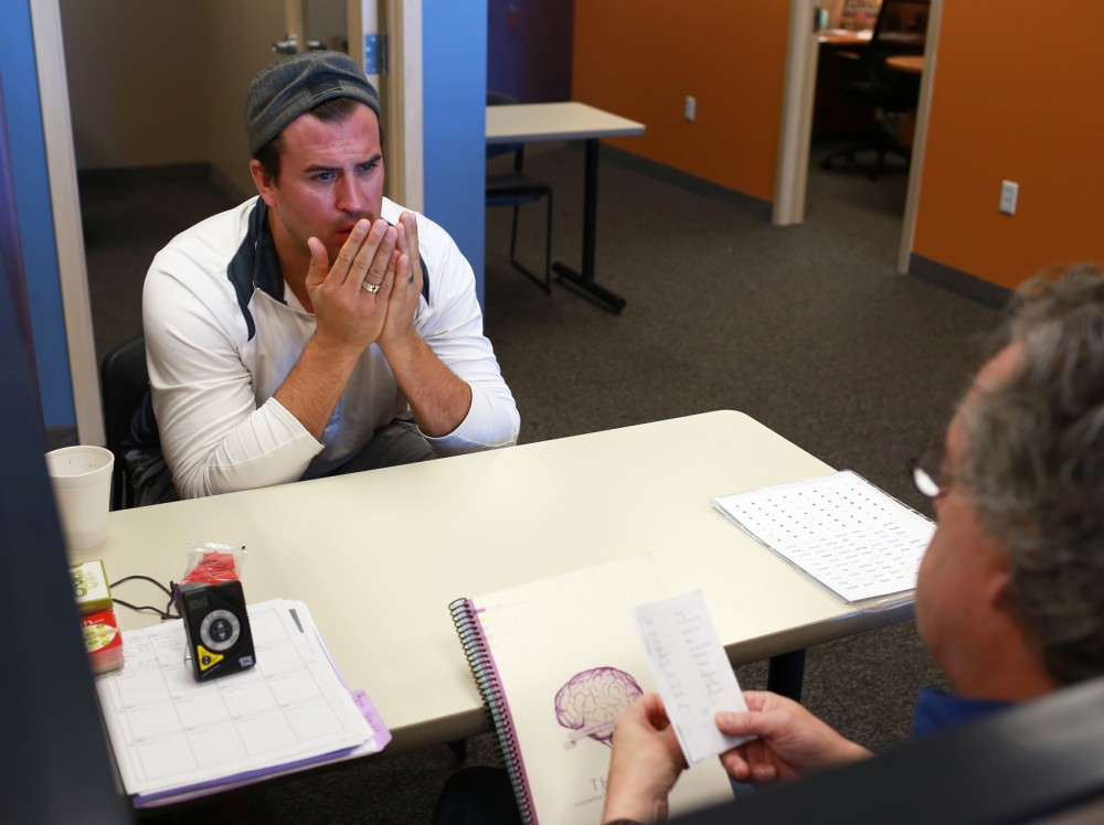 Former Gophers Football tight end Ben Utecht concentrates, trying to recall a lengthy list of words recited to him by his mental trainer Brad Olson at the Learning RX Brain Training Center in Savage, MN on Friday. Utecht, an advocate for brain health, has been utilizing Learning RX's services to improve his mental abilities after experiencing symptoms due to suffering 5 documented concussions during his professional football career.