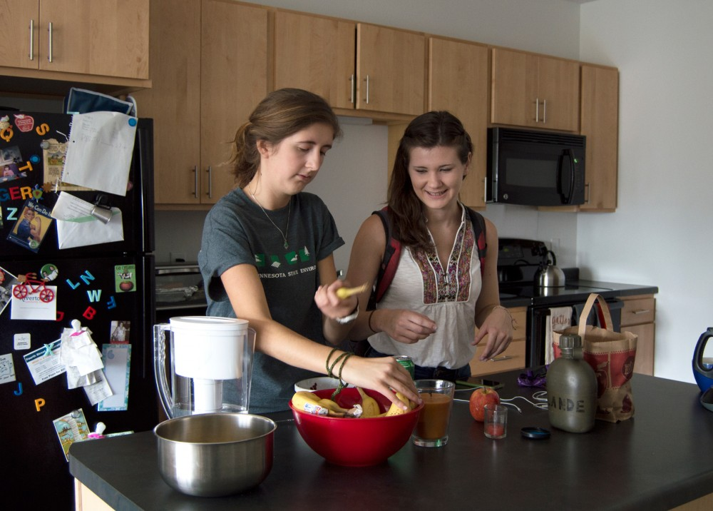 Sophomores Tatiana Lyons and Elayna Shapiro chat in their apartment in the Fourth Street Cooperative on Tuesday.