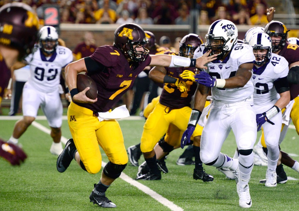 Minnesota quarterback Mitch Leidner faces pressure on Thursday evening at TCF Bank Stadium.  The Gophers lost to Texas Christian University 23-17 in their first game of the season.