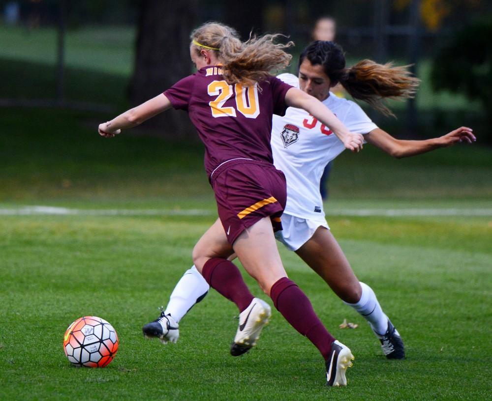 Freshman April Bockin dribbles the ball down the field on Fridays game against the New Mexico Labos. The Gophers won 1-0.