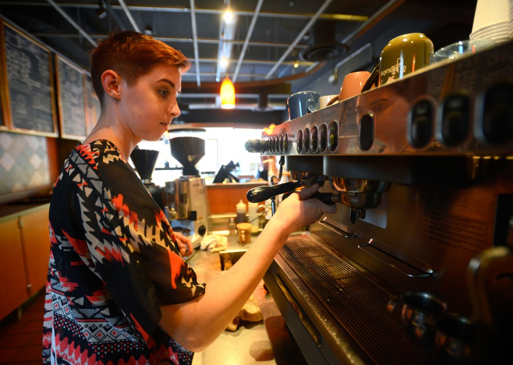 Espresso Exposé manager Dana Heinz prepares a drink on Monday. In August, Minnesota wages were raised to $9, and the findings of a newly preposed study could lead to another increase.
