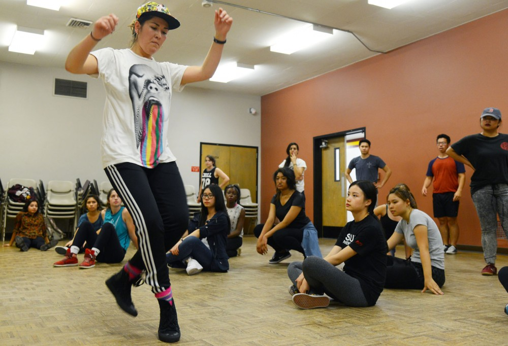 Guest choreographer Kamiko Higashi demonstrates dance steps during a workshop for the hip-hop dance crew Hip Hope in Peik Gymnasium on Wednesday. The group is scheduled to preform in the homecoming parade on Friday.
