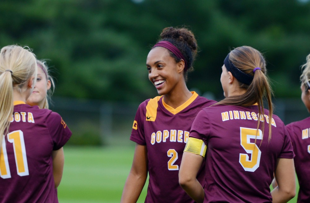 Simone Kolander laughs with other Gopher women's soccer teammates before their game against the New Mexico Labos on Sept. 11, 2015 at Elizabeth Lyles Robbie Stadium.