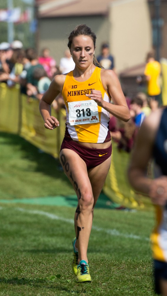 Junior Haley Johnson runs the final stretch of the Roy Griak Invitational at Les Bolstad on Saturday. Johnson placed twelfth as an individual and the women's team placed third overall.