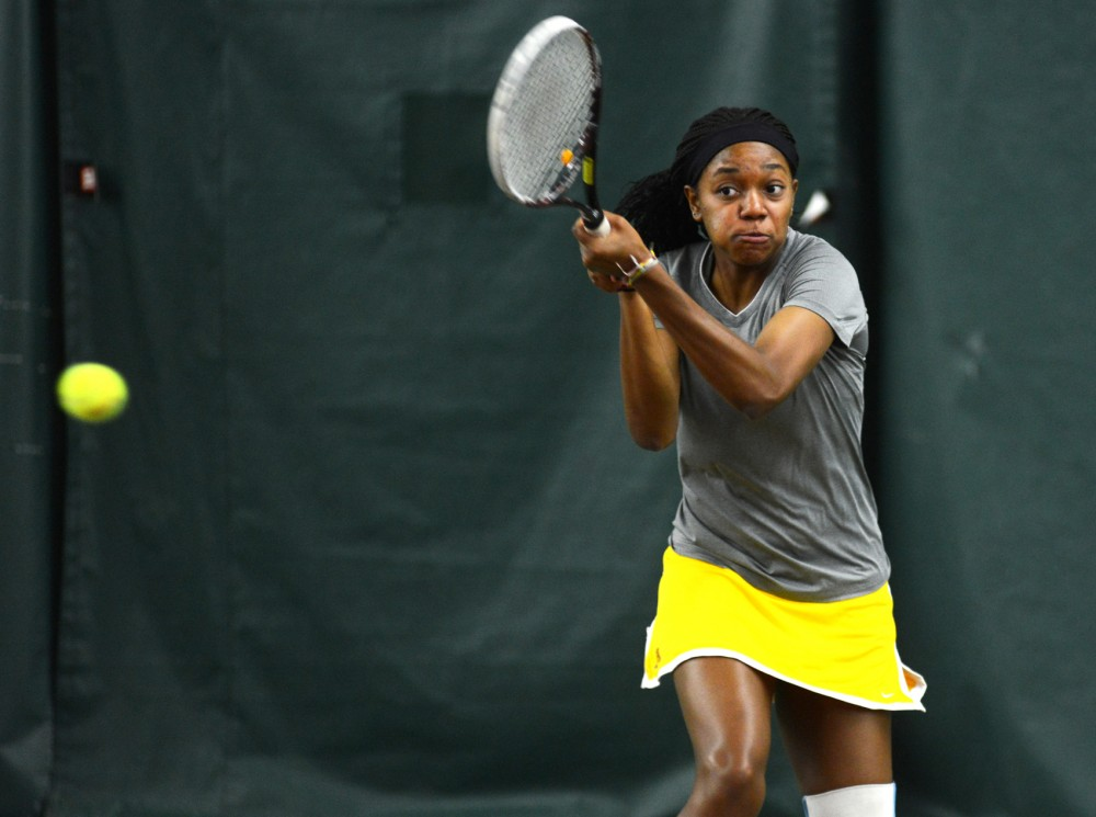 Gophers fourth year Jessika Mozia hits the ball during the Gopher Invitational at Baseline Tennis Center on Saturday, September 26.