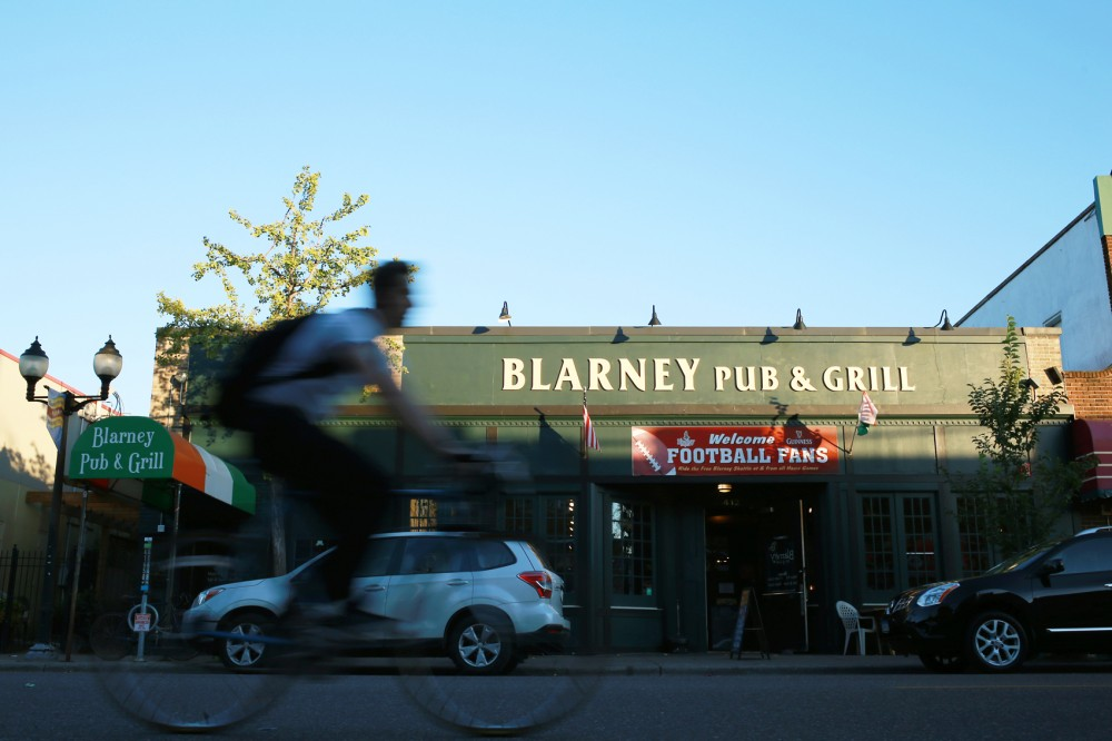 A biker passes by Blarney Pub & Grill on Wednesday. In September, the Minneapolis City Council issued a proposal for a city-wide ordinance that would change the way all businesses, like Blarney, are allowed to schedule their employees. The changes would require businesses to establish employee shift schedules twenty-eight days before their shift.