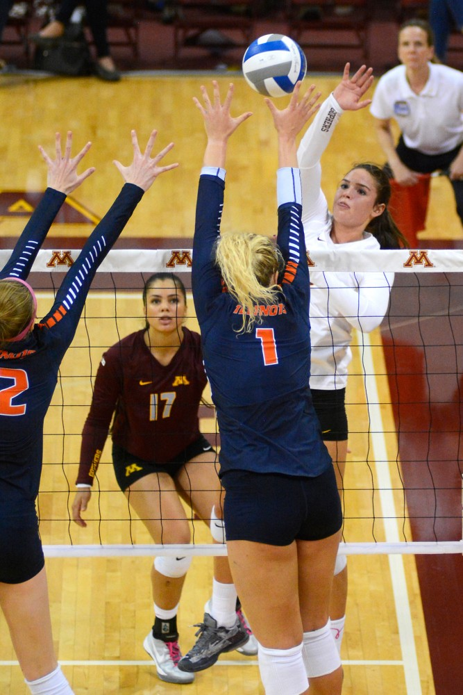 Outside Hitter Sarah Wilhite hits the ball over the net at the Sports Pavilion where the Gophers defeated No. 7 Illinois on Saturday.