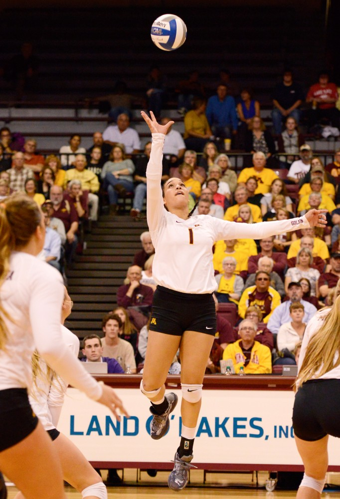 Outside hitter Daly Santana jumps for the ball against Northwestern University at the Sports Pavilion on Sept. 30.