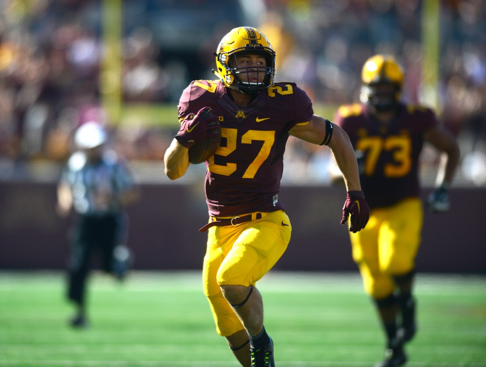 Running back Shannon Brooks runs toward the end zone at TCF Bank Stadium on Saturday, Sept. 26.