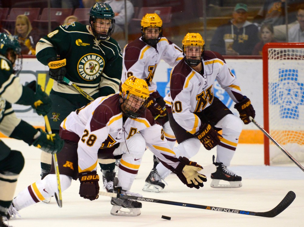 Gophers defender Jake Bischoff dives to stop the puck during the first game of the 2015-16 season at Mariucci Arena on Saturday where the Gophers fell to Vermont, ending with a final score of 0-3.
