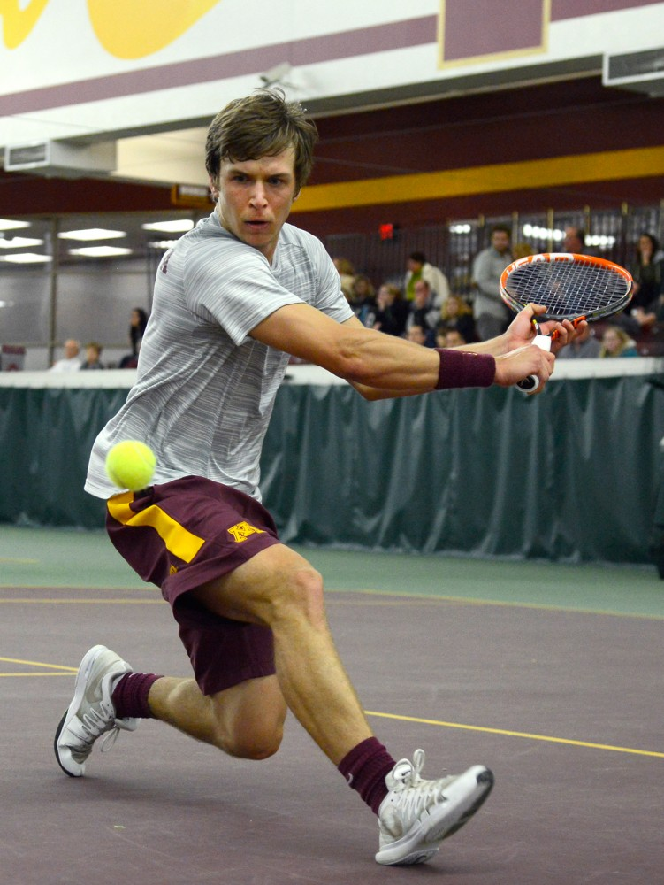 Freshman Matic Spec prepares to hit the ball at the Baseline Tennis Center on Friday, March 27.