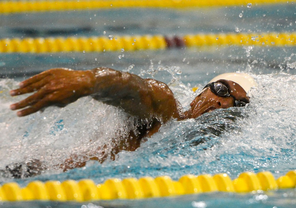 Daryl Turner swims the 100 free at the Aquatic Center on Oct. 24, 2014.