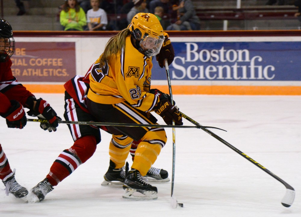 Hannah Brandt maneuvers the puck towards the goal during the third period at Ridder Arena Friday evening where the Gophers defeated St. Cloud state 7-0.