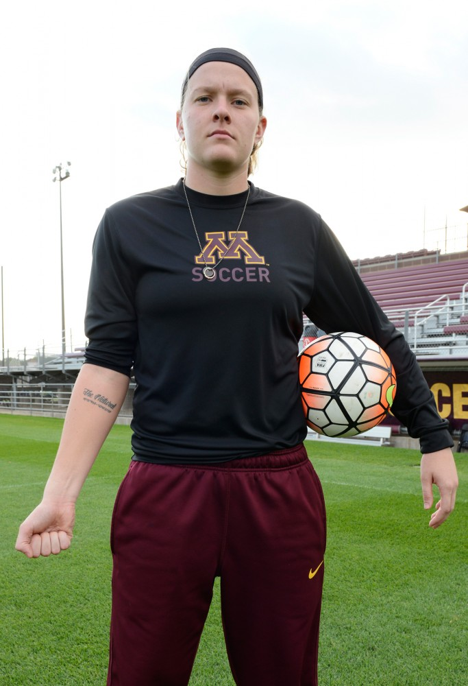 Junior and Gophers Soccer goalkeeper Tarah Hobbs poses, displaying her recently acquired tattoo dedicated to her father at the Elizabeth Lyle Robbie Stadium on Tuesday, October 6.