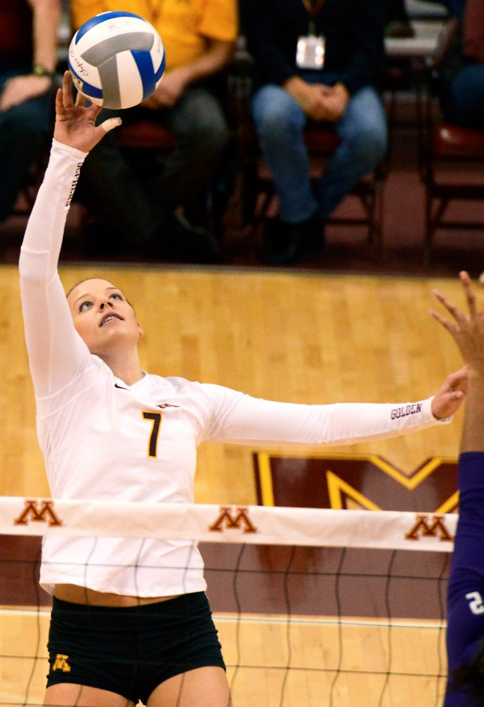 Middle blocker Hannah Tapp strikes the ball against Northwestern on Sept. 30, at the Sports Pavilion.