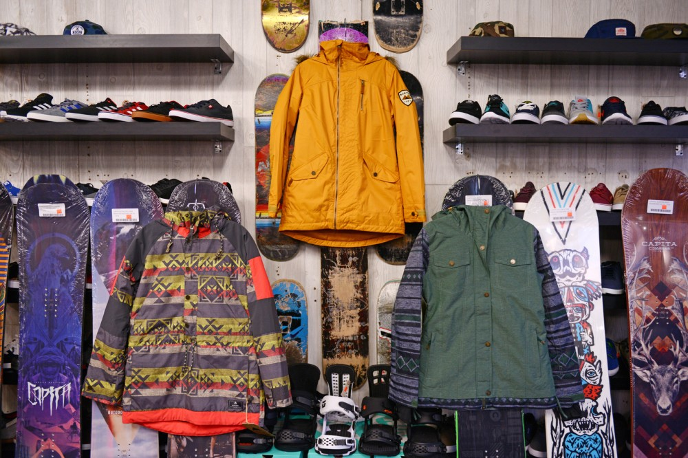 (From left to right) The Burton Cinder Anorak in tropic navajo, the Burton Hazel in squashed and the Roxy Cedar jacket in jungle green, hang at the House Boardshop on Tuesday. The House carries a multitude of this years latest winter jackets and base layers.