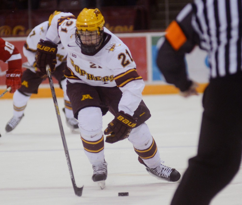 Gophers forward Connor Reilly races the puck down the ice at Mariucci Arena, Jan. 16, 2015.