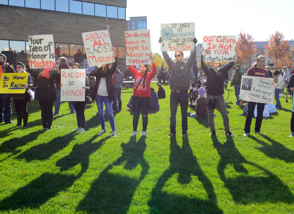 Demonstrators occupy the lawn outside of TCF Bank Stadium on Sunday morning. The demonstration took place to voice opposition against the team mascot of the Kansas City Chiefs during their game against the Minnesota Vikings.