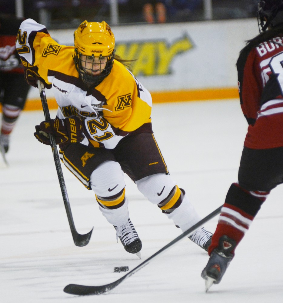 Gophers forward Dani Cameranesi moves the puck toward the net at Ridder Arena, Jan. 25, 2014.