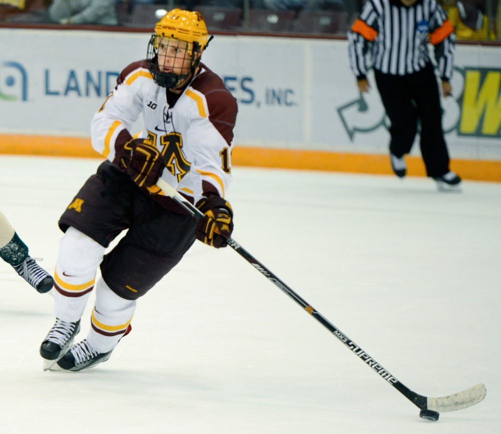 Gophers defender Nick Seeler skates during the first game of the 2015-16 season at Mariucci Arena on Oct. 10, when the Gophers fell to the University of Vermont, ending with a final score of 3-0.