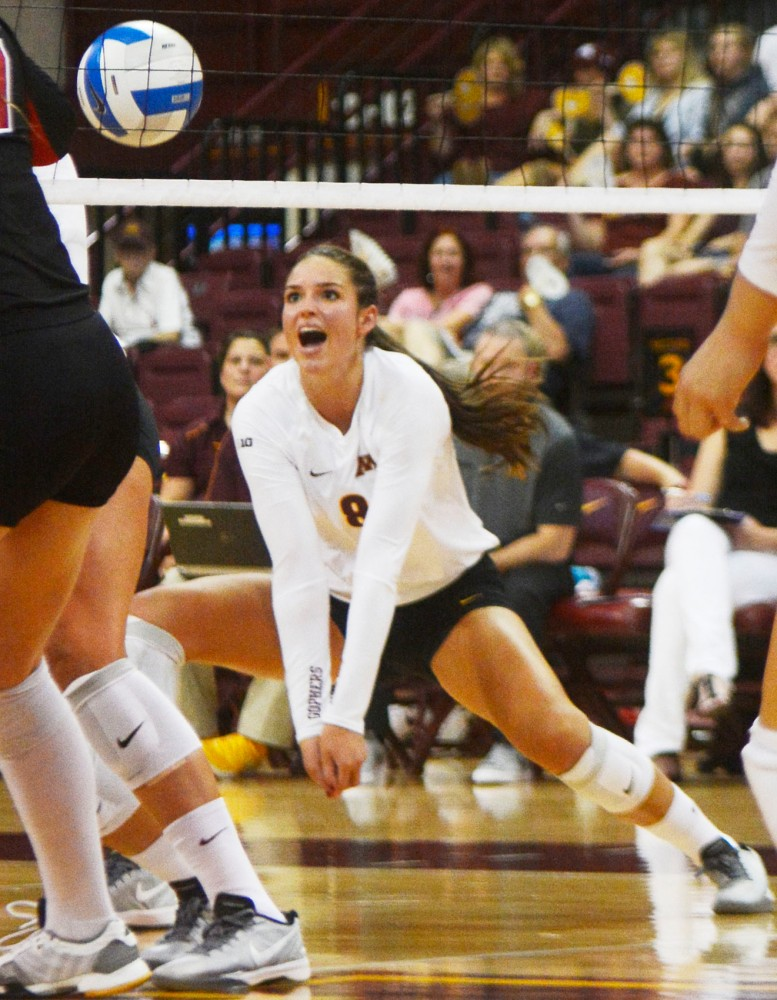 University of Minnesota outside hitter Sarah Wilhite lunges for the ball Aug. 30, 2014, at the Sports Pavilion.