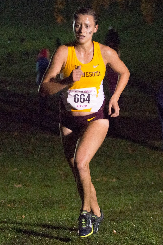 Red shirt freshman Courtney Alama competes in Jack's Twilight Run at Les Bolstad golf course on Friday. Alama was the second female finisher in the race dedicated to late Minnesota equipment manager Jack Johnson.
