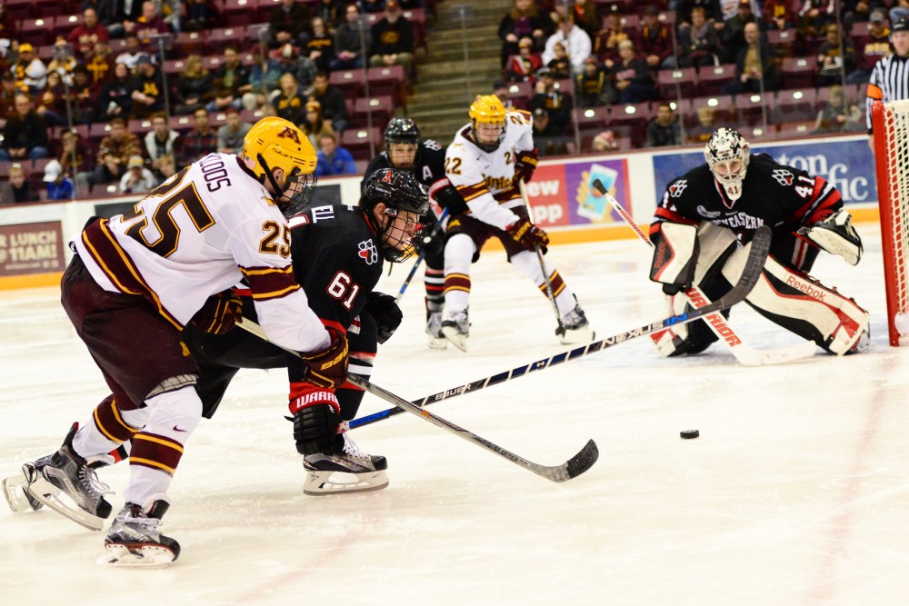 Forward Justin Kloos attempts to score against Northeastern in Mariucci Arena on Saturday night.